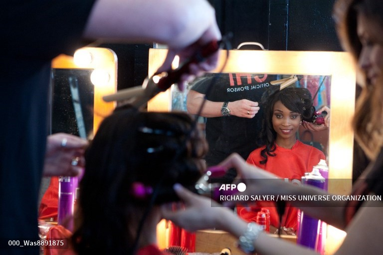 This picture provided by the Miss Universe Organization shows Nale Boniface, Miss Tanzania 2014, getting her hair done by CHI hair stylists upon arriving to Trump National Doral Miami on January 4, 2015