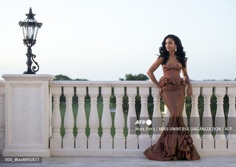 UNITED STATES, Doral : This picture provided by the Miss Universe Organization shows Niketa Barker, Miss Guyana 2014, posing in her evening gown upon arriving to Trump National Doral Miami on January 4, 2015.